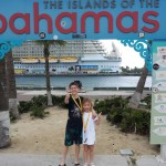 Kids in Front of Bahamas Sign