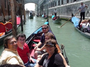 Enjoying a gondola ride while in Venice on Grandeur of the Seas