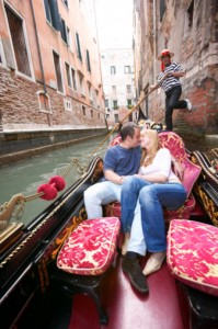 couple in gondola in Venetian canal